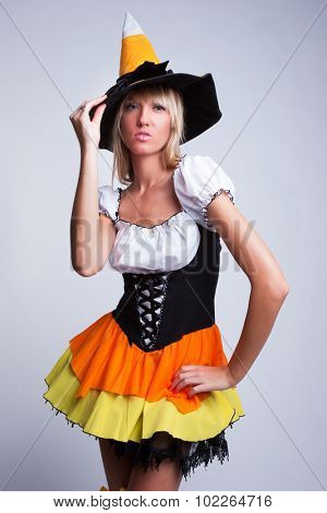 Beautiful woman dressed as halloween witch