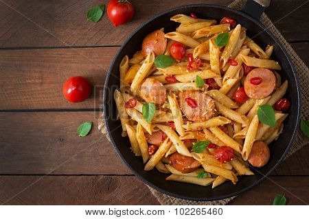 Penne pasta with tomatoes and sausage