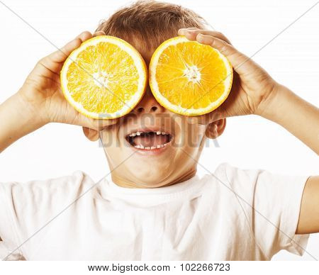 little cute boy with orange fruit double isolated on white smiling without front teeth