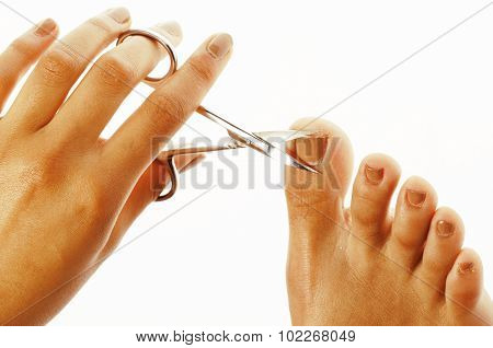woman hands making no qualified manicure to herself isolated with tools