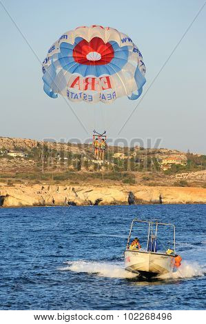 Attraction flight over the sea on a parachute extreme entertainment