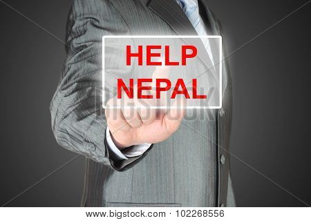 Businessman pushing virtual help Nepal button
