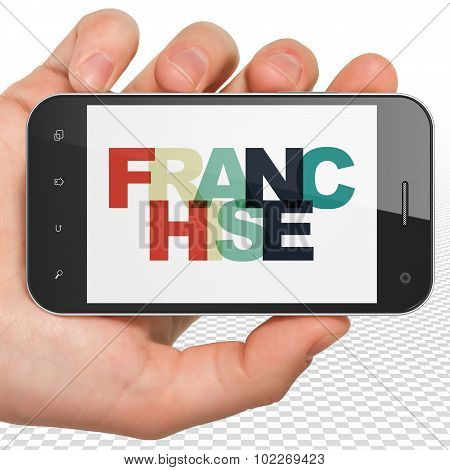Finance concept: Hand Holding Smartphone with Franchise on  display