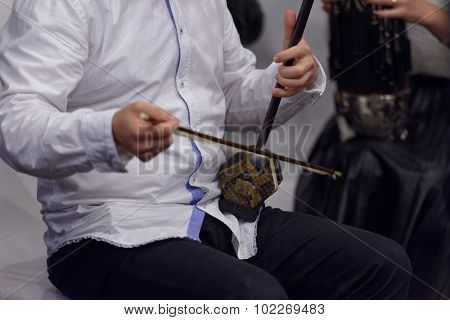 ST. PETERSBURG, RUSSIA - SEPTEMBER 14, 2015: Musician plays erhu during the press cocktail of the women's chamber orchestra