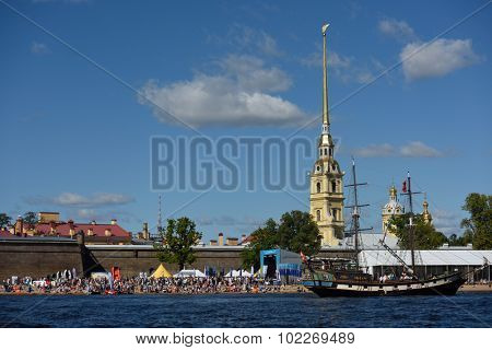 ST. PETERSBURG, RUSSIA - AUGUST 15, 2015: Sailing ships parade during the International marine festival in the Peter and Paul fortress. The fest is main event of the Great St. Petersburg Sailing Week