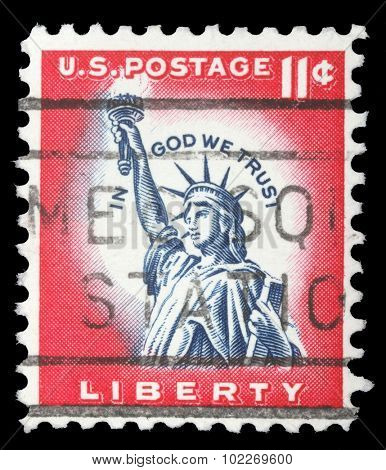 UNITED STATES - CIRCA 1970: An 11 cents stamp printed in the United States features statue of liberty and inscription In god we trust, circa 1970