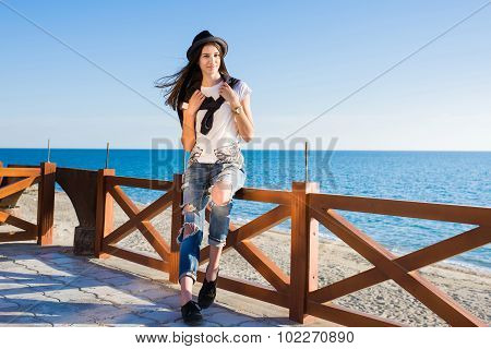 Attractive brunette hair woman dressed in stylish clothes enjoying good sunny weather during promena