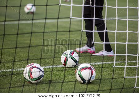 Balls Of Paok Team On The Field Of The Stadium Behind Net During Team Practice In Thessaloniki, Gree