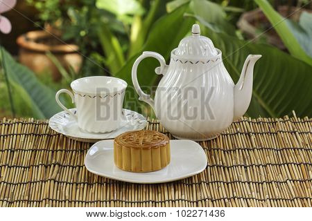 Moon Cake With Golden Lotus Seed And Macadamia Nut And Cup Of Tea