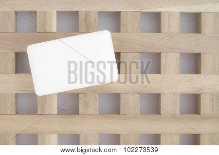 White Soap On A Textured Wooden Background