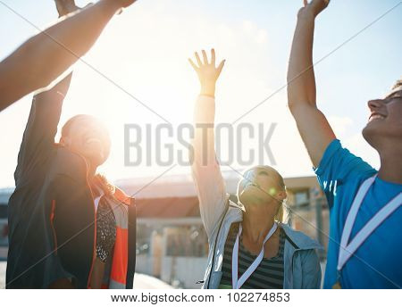 Successful Team Of Athletes Cheering Victory