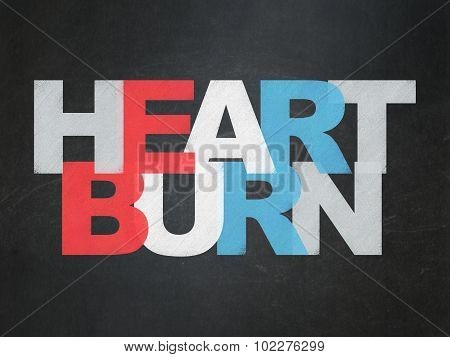 Medicine concept: Heartburn on School Board background