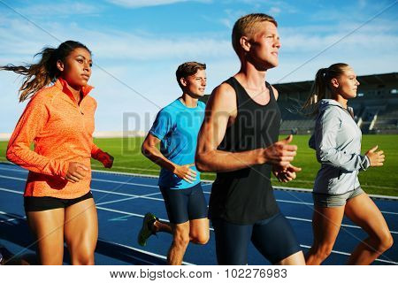 Group Of Multiracial Professional Runners Practicing