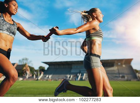 Female Relay Team Passing The Baton