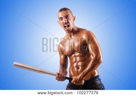 Muscular man with baseball bat