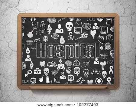 Health concept: Hospital on School Board background