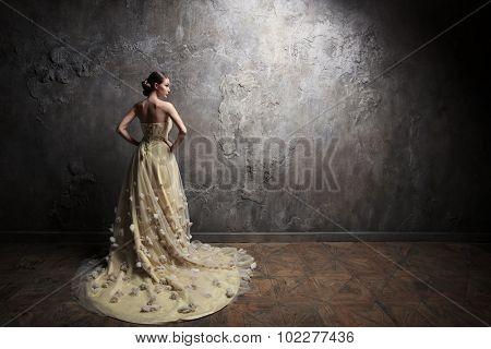 Young beautiful girl in a dress