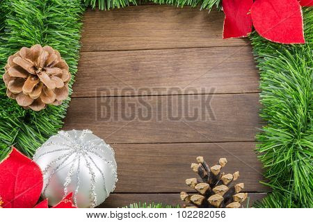 Christmas Decoration With Silver Bauble And Poinsettia On Wooden Background