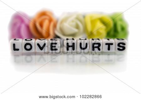 Love Hurts With Black Text