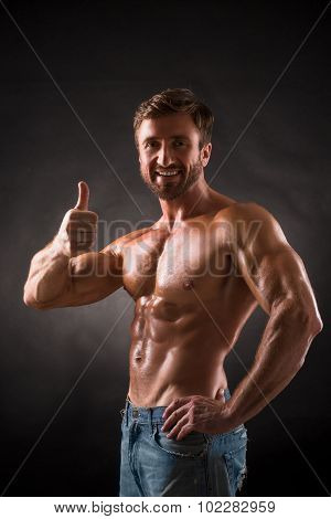 Smiling shirtless mascular man