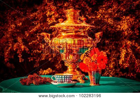 Russian Gold Samovar And Cup Of Tea, Cones, Which Stoked The Samovar, Calendula In A Silver Vase And