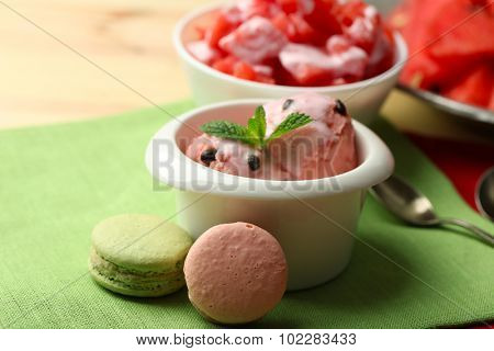 Watermelon ice cream in bowls and fresh watermelon pieces  on color wooden background