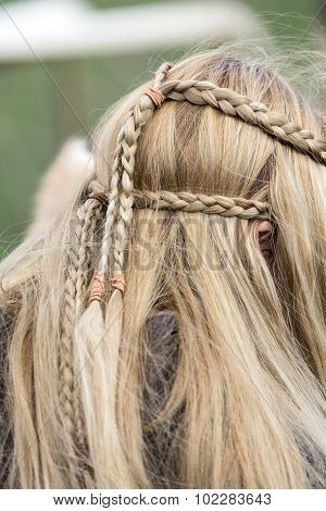 Close up of plaited hair on young girl head