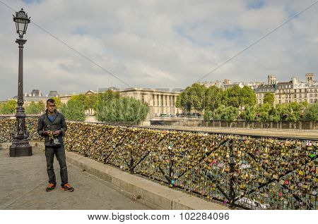 Locks left by lovers on bridge in Paris
