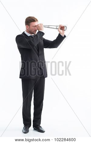 Businessman using telescope