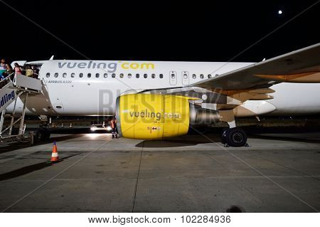 SANTORINI, GREECE - AUGUST 05, 2015: Vueling Airbus A320. Vueling Airlines, S.A. is a Spanish low-cost airline based at El Prat de Llobregat in Greater Barcelona