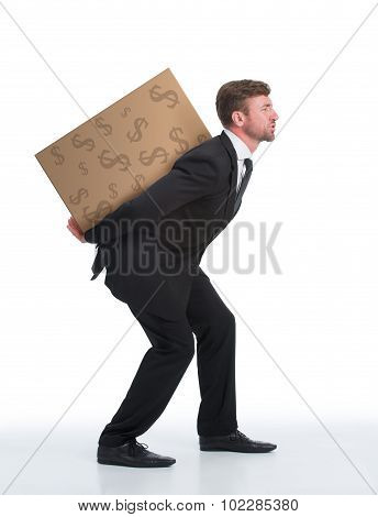 Businessman carrying heavy load with money on his back