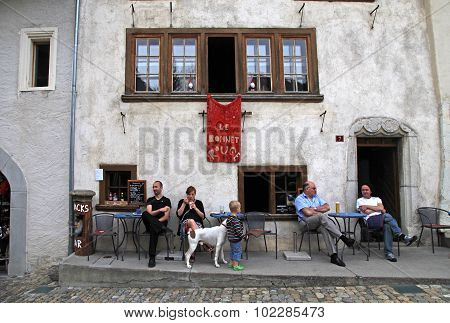 sidewalk cafe in the swiss village Gruyeres, Switzerland.