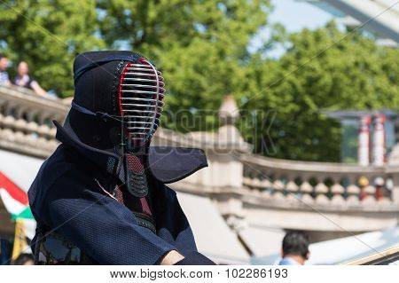 Kendo Fighter In Traditional Clothes With Bamboo Sword