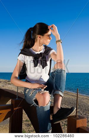 Portrait of a fashionable women relaxing after strolling near the sea