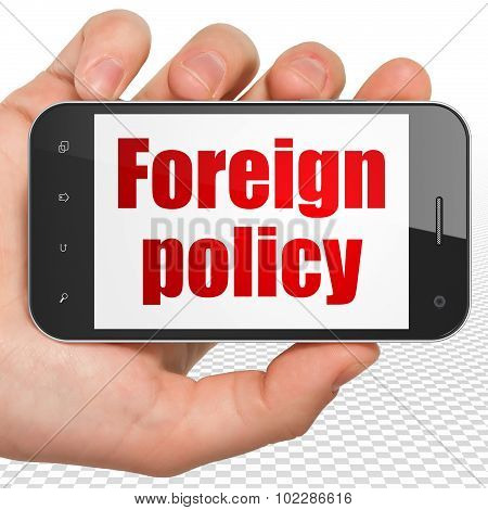 Politics concept: Hand Holding Smartphone with Foreign Policy on display