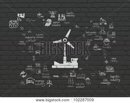 Industry concept: Windmill on wall background