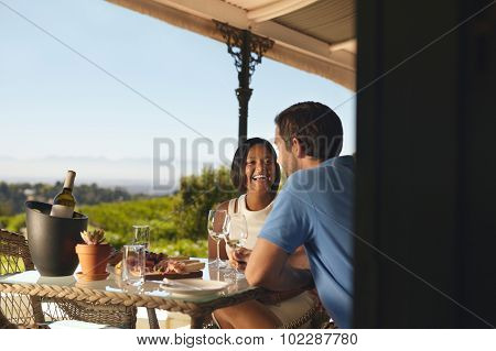 Happy Young Couple Drinking Wine At Winery