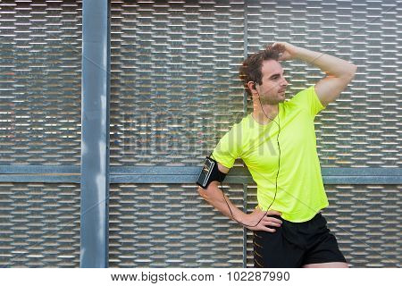 Young handsome athletic man posing outdoors