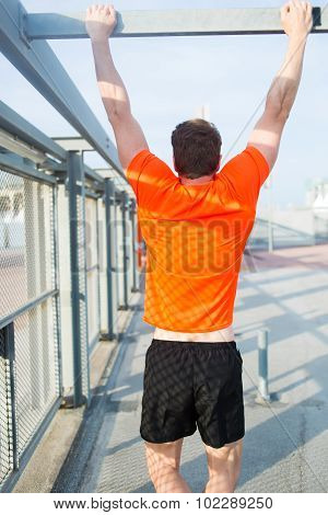 Athletic jogger in bright copy space t-shirt working out hard at sunny afternoon outside