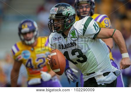 VIENNA, AUSTRIA - JUNE 22, 2014: WR Thomas Haider (#13 Dragons) runs with the ball.