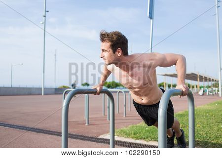 Handsome male runner warming up before began his morning workout training