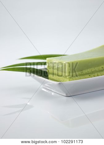 green pandan layer cake on the plate