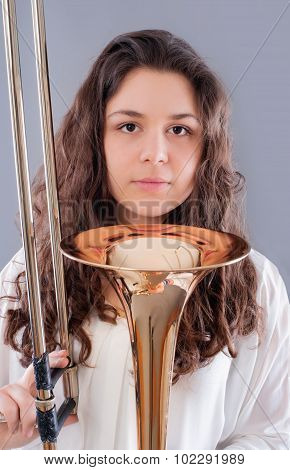 Teenage girl with trombone