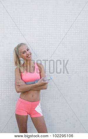 Young female runner resting after workout in the fresh air