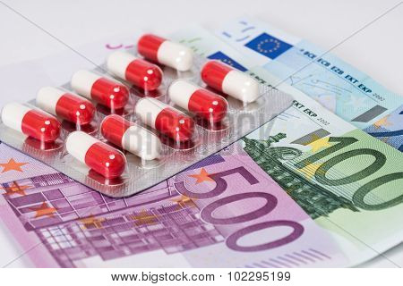 Antibiotic Capsules In Blister With Euro Banknotes