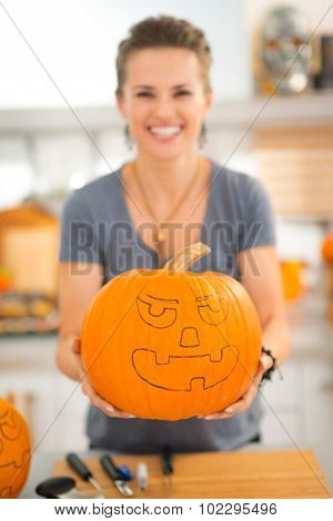 Woman Holding Pumpkin Jack-o-lantern For Halloween. Closeup