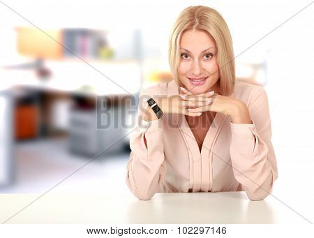 Beauty girl portrait. Young natural woman with clean face sitting at white table leaning on her elbo