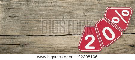 twenty percent off discount - price tag on rustic old wooden background
