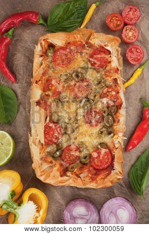 Phyllo pastry pizza with cheese and cherry tomato