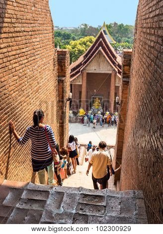 An unidentified groups of tourists and travelers in Wat Yai Chai Mongkol temple in Ayutthaya Thailand